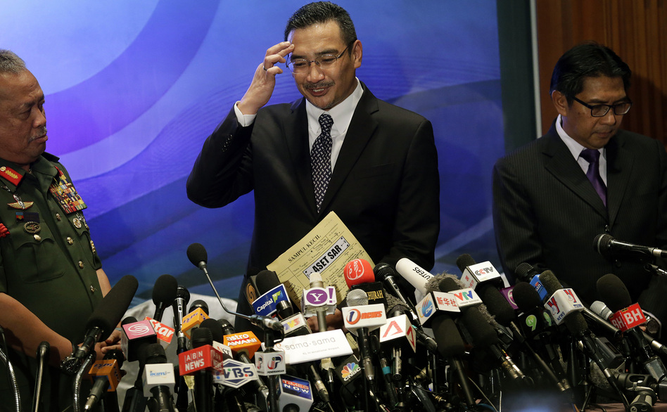 Scratching their heads: Malaysia's minister of transport, Hishamuddin Hussein (center), tried to answer reporters' questions Wednesday about the disappearance of Malaysia Airlines Flight 370. He was joined by Azharuddin Abdul Rahman, director general of the Malaysian Department of Civil Aviation, and Gen. Zulkifeli Mohd Zin. Wong Maye-E/AP