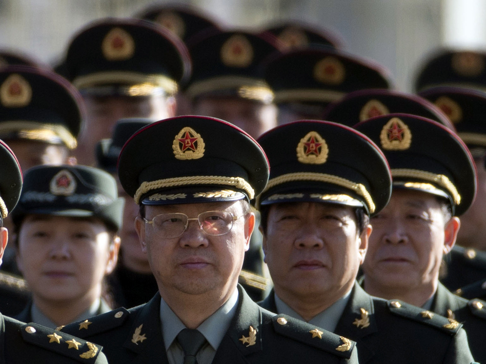 Delegates from China's People's Liberation Army (PLA) march from Tiananmen Square to the Great Hall of the People to attend sessions of National People's Congress and Chinese People's Political Consultative Conference Tuesday in Beijing. Ng Han Guan/AP