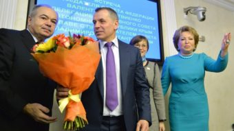 Vladimir Konstantinov (in purple tie) is the speaker of Crimea's parliament. He was welcomed with flowers Friday during his meeting with Valentina Matviyenko, speaker of Russia's upper house of parliament. She is at the far right of this photo. Yuri Kadobnov/AFP/Getty Images