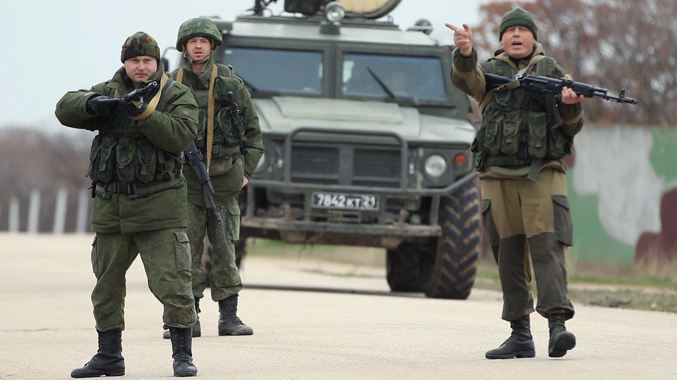 Troops under Russian command scream orders to turn back before firing warning shots at the Belbek airbase in Crimea. The troops were reacting to a large group of unarmed Ukrainian troops who approached them. Sean Gallup/Getty Images