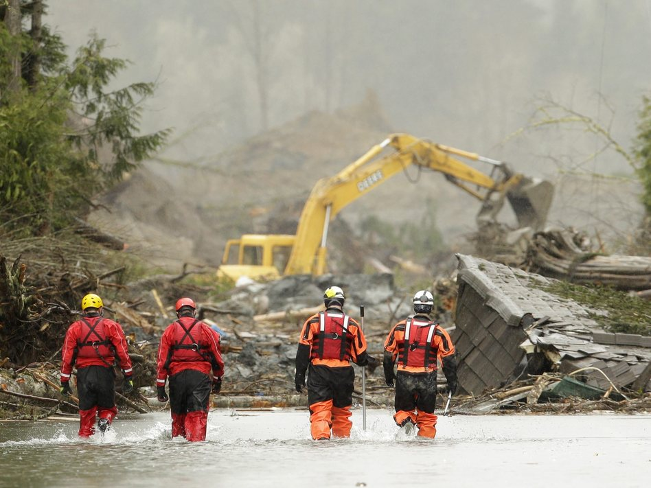 Searchers approach the site of the mudslide in Oso, Wash., that tore through about 50 homes and properties. Ted S. Warren/pool /EPA/Landov