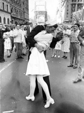 As pedestrians watch, an American sailor passionately kisses a white-uniformed nurse in Times Square to celebrate the long awaited-victory over Japan on August 14, 1945. Alfred Eisenstaedt/Time & Life Pictures/Getty Images