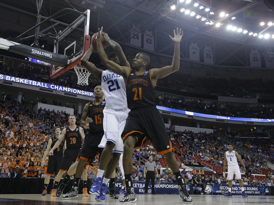 Duke forward Amile Jefferson, in white, and Mercer guard Langston Hall battle for the ball during Friday's game. Gerry Broome/AP