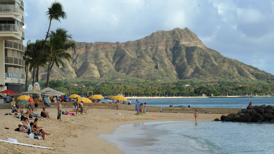 Waikiki Beach in Honolulu, with Diamond Head in the background. State lawmakers are vowing to get rid of a provision in Hawaiian law that allows law enforcement officers to have sex with prostitutes if doing so is within the scope of their duties. Robyn Beck /AFP/Getty Images