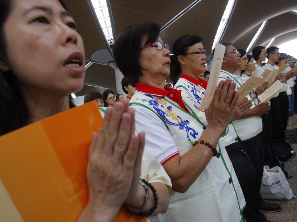 At Kuala Lumpur International Airport on Sunday, prayers were said for the 239 people who have been missing since flight MH370 disappeared. Lai Seng Sin/AP