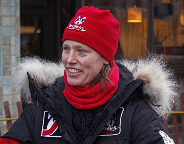 Aliy Zirkle greets fans at the ceremonial start of the 2013 Iditarod in Anchorage. Photo by Josh Edge, APRN – Anchorage.