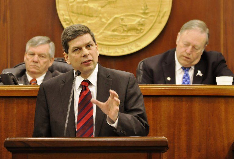 U.S. Sen. Mark Begich spoke to Alaska legislators Monday. Senate President Charlie Huggins is left. House Speaker Mike Chenault is on the right. (Photo by Skip Gray/Gavel Alaska)