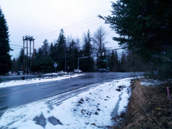 The view of the Mendenhall Loop and Atlin Drive intersection from the property's driveway. (Photo by Heather Bryant/KTOO)