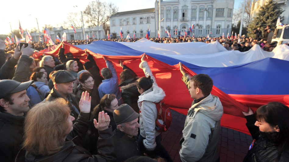 Demonstrators carry a Russian flag during a rally this week in the western Crimean city of Yevpatoria. Genya Savilov /AFP/Getty Images