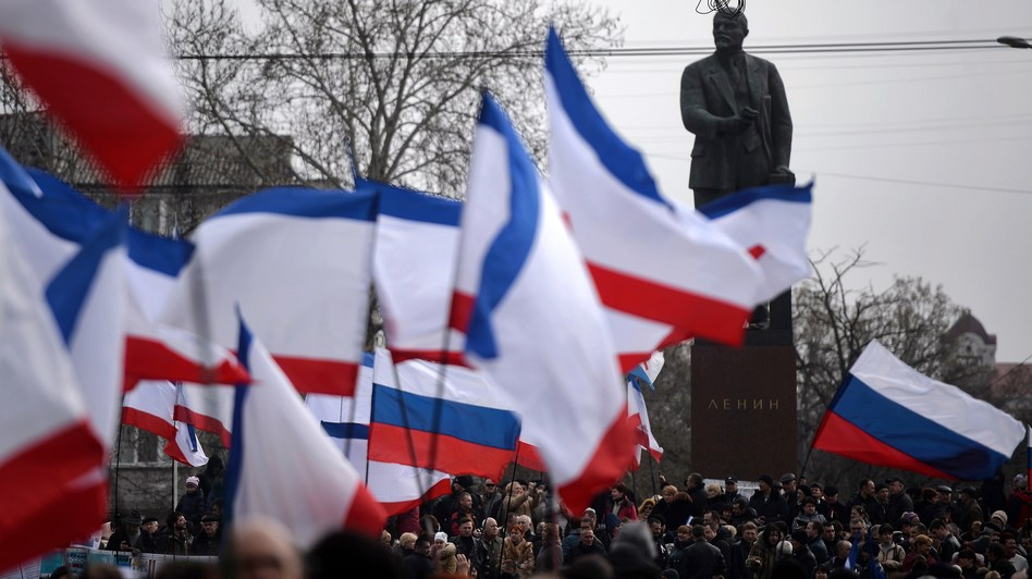 Russian and Crimean flags were being waved during a pro-Russia rally Sunday in Simferopol's Lenin Square. Simferopol is the capital of Crimea, an autonomous region of Ukraine. Filippo Monteforte /AFP/Getty Images