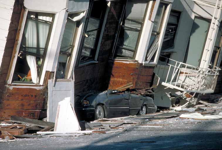 An automobile lies crushed under the third story of this apartment building in San Francisco after the 1989 earthquake. (Photo by J.K. Nakata/U.S. Geological Survey)