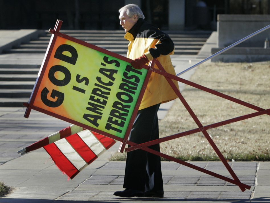 July 2007: The Rev. Fred Phelps Sr. prepares to protest outside the Kansas Statehouse in Topeka, Kan. Orlin Wagner/AP