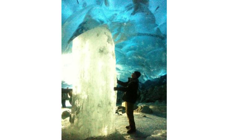 Backlit ice pillar