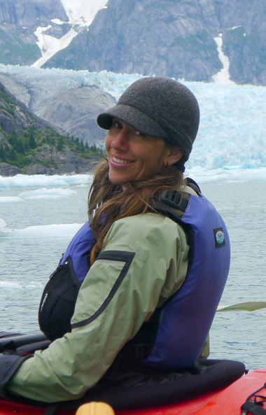 New SEACC Executive Director Malena Marvin poses while kayaking in Juneau's Mendenhall Lake. (SEACC Photo)