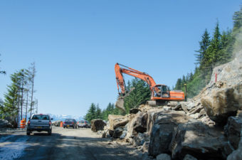 Construction has extended Glacier Highway to Cascade Point. Here crews are shown working on widening parts of the existing road in June of 2013. (Photo by Heather Bryant/KTOO)
