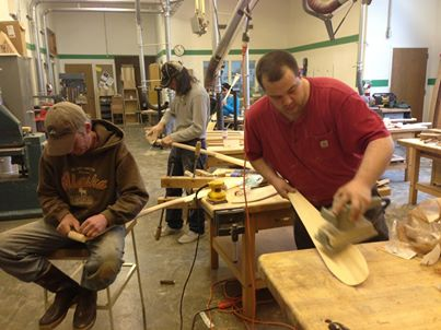 Paddle makers at the One People Canoe Society workshop. (Photo by Shady Grove Oliver/KSTK)