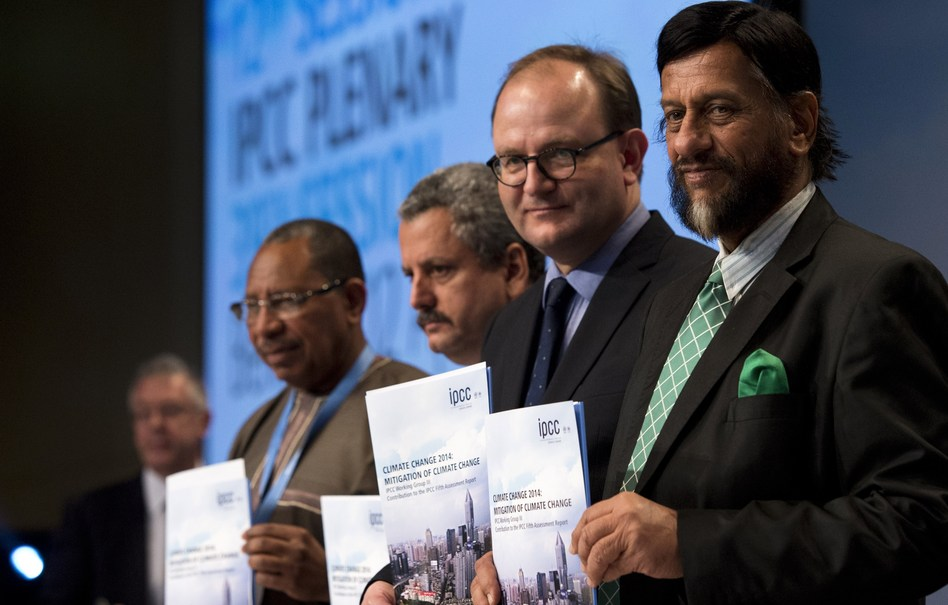 The world must cut its greenhouse gas emissions to meet its goals, climate experts said Sunday. Members of the Intergovernmental Panel on Climate Change (left to right) Youba Sakona, Ramon Pichs Madruga, Ottmar Edenhofer and Rajendra Pachauri hold copies of their new report in Berlin. John MacDougall/AFP/Getty Images