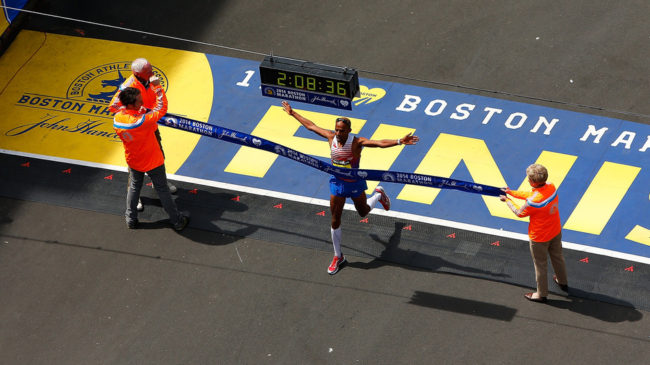 American Meb Keflezighi crosses the finish line in first place to win the 2014 B.A.A. Boston Marathon on Monday. He became the first American man to win the Boston Marathon since 1983. Jared Wickerham/Getty Images