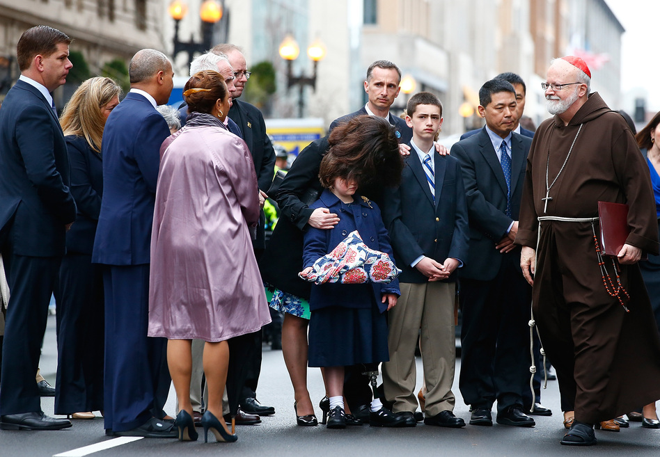 One year after the Boston Marathon bombings, families of the victims, including relatives of Martin Richard, attended a wreath-laying ceremony on Boylston Street along with Mayor Martin Walsh (left) and Cardinal Sean Patrick O'Malley (right). Jared Wickerham/Getty Images