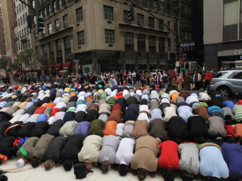 Men pray on the street before the start of the American Muslim Day Parade in 2010 in New York. Spencer Platt/Getty Images