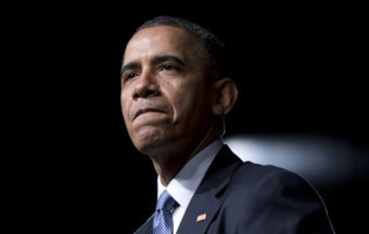 President Obama pauses while speaking at the LBJ Presidential Library, on Thursday in Austin, Texas. Carolyn Kaster/AP