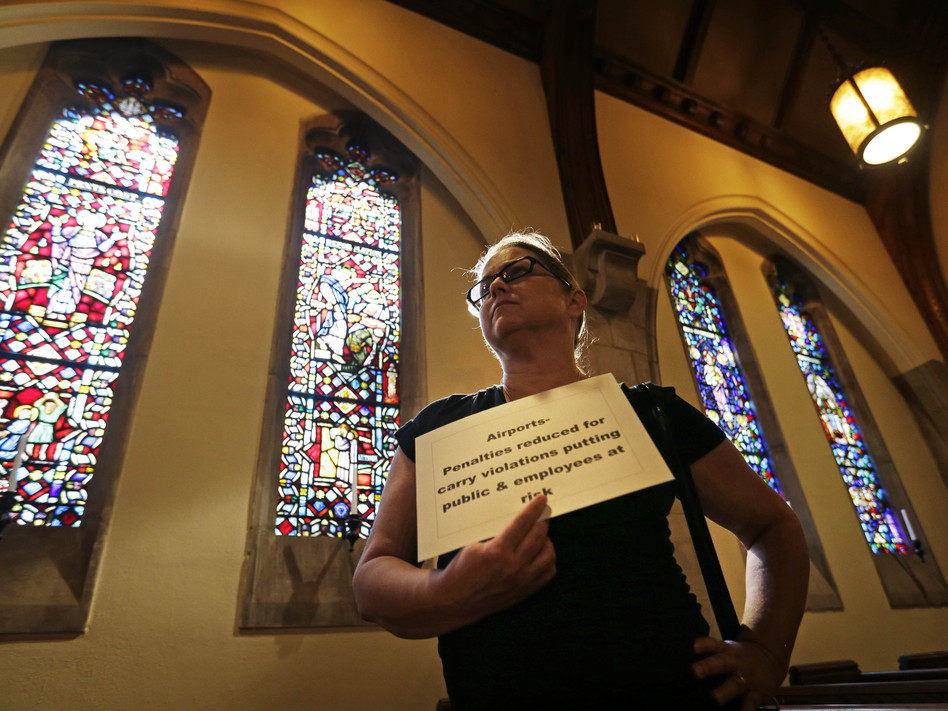 Andrea Teichner protests Georgia's new gun law at a rally at Atlanta's Central Presbyterian Church, on Wednesday. (David Goldman/AP)