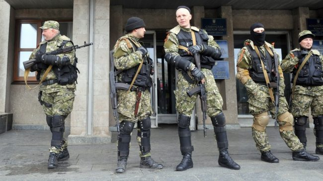 Armed men in military fatigues stood guard Monday outside a regional administration building they seized in the eastern Ukrainian city of Slovyansk. Genya Savilov /AFP/Getty Images