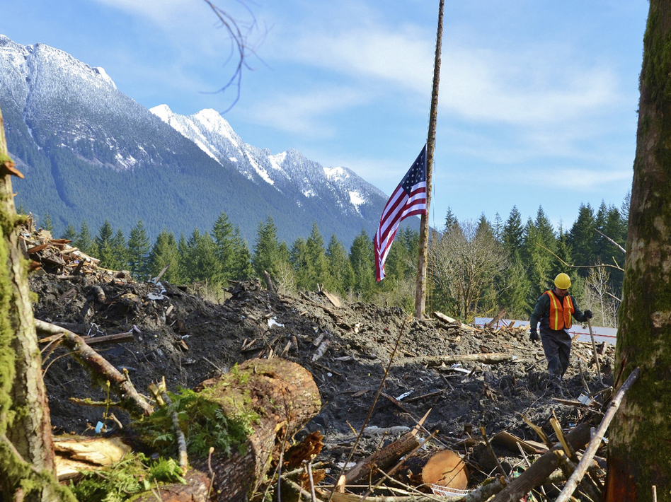 A flag flies at half-staff in the midst of the mudslide rubble in Oso, Wash. U.S. Army National Guard/handout/Reuters/Landov