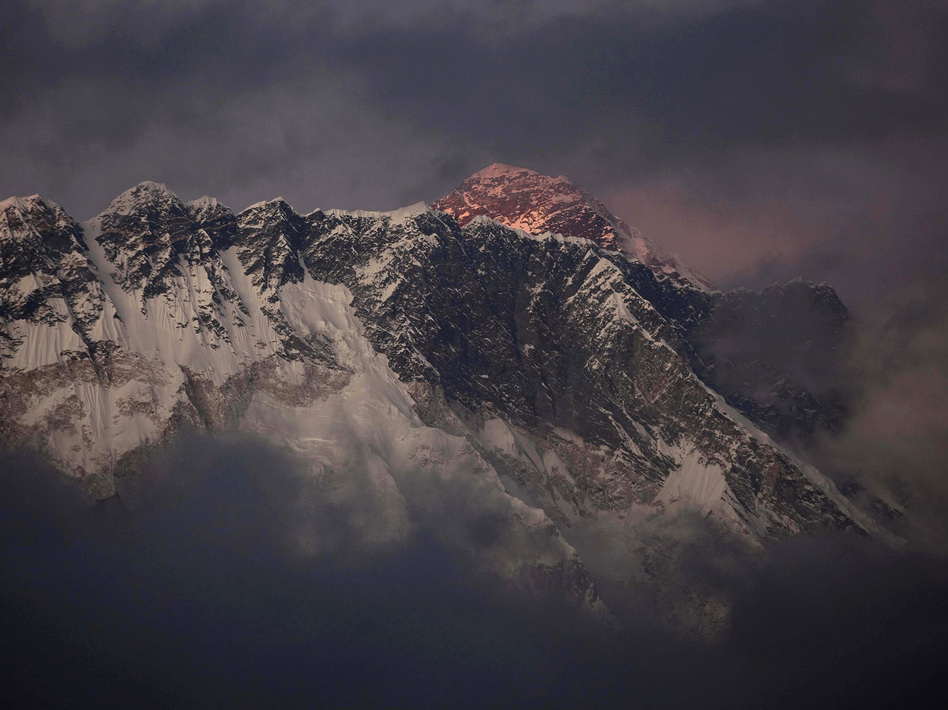 The sun shines on the peak of Mount Everest in this October 2011 photo. On Friday, an avalanche killed at least 12 Sherpas on the mountain. Kevin Frayer/AP