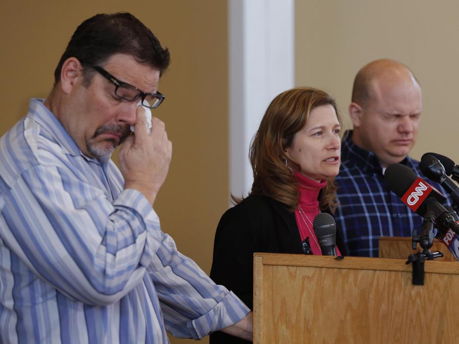 Mindy Corporon speaks during a news conference, flanked by Will Corporon (left) and Tony Corporon, at their church in Leawood, Kan., on Monday. Their father, Dr. William Corporon, and Mindy Corporon's 14-year-old son were killed during Sunday's shooting at the Jewish Community Center in Overland Park, Kan. Orlin Wagner/AP