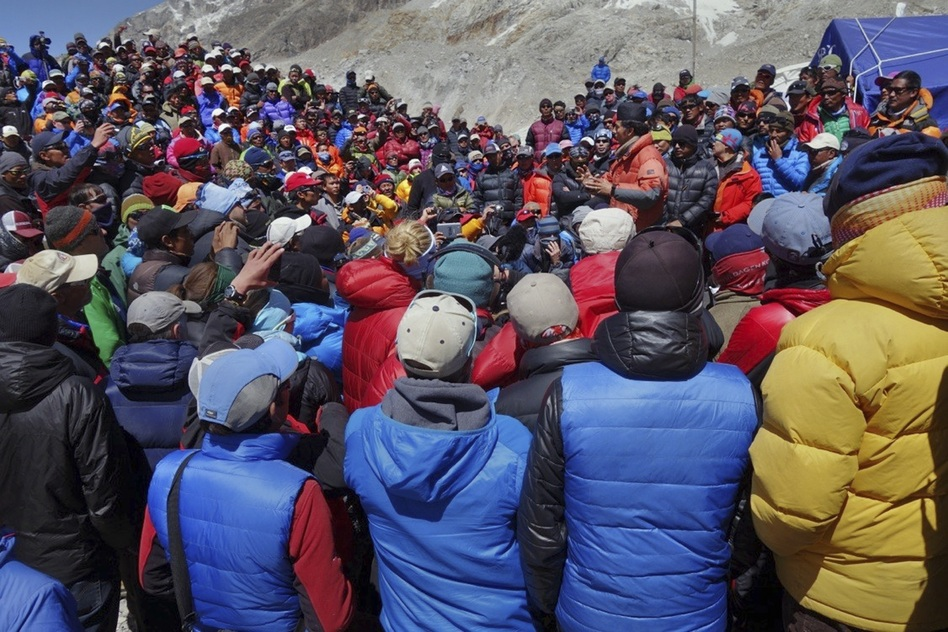 A Nepalese government delegation met with Sherpa mountain guides near Mount Everest's base camp on the south side of the mountain Thursday. The government was hoping to convince the guides to continue working even though 16 Sherpas had died a week earlier. But fresh ice avalanches on Friday appear to have doomed Nepal's climbing season. (Adrian Ballinger/Alpenglow Expeditions/AP)