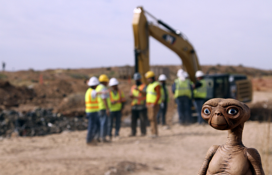 An E.T. doll was held up at the site of an exploratory dig for old Atari video games Saturday. Workers dug into a landfill in Alamogordo, N.M., that had long been rumored to be the final resting place of millions of copies of the game E.T. The Extra-Terrestrial. Juan Carlos Llorca/AP