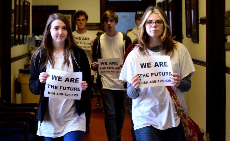 A pack of 18 youths walked the halls of the State Capitol, April 16, 2014, in a silent demonstration asking for more education funding. Bridget Galvin, a junior at Steller Secondary School in Anchorage and founder of Students With a Voice organized the event. (Skip Gray/Gavel Alaska)