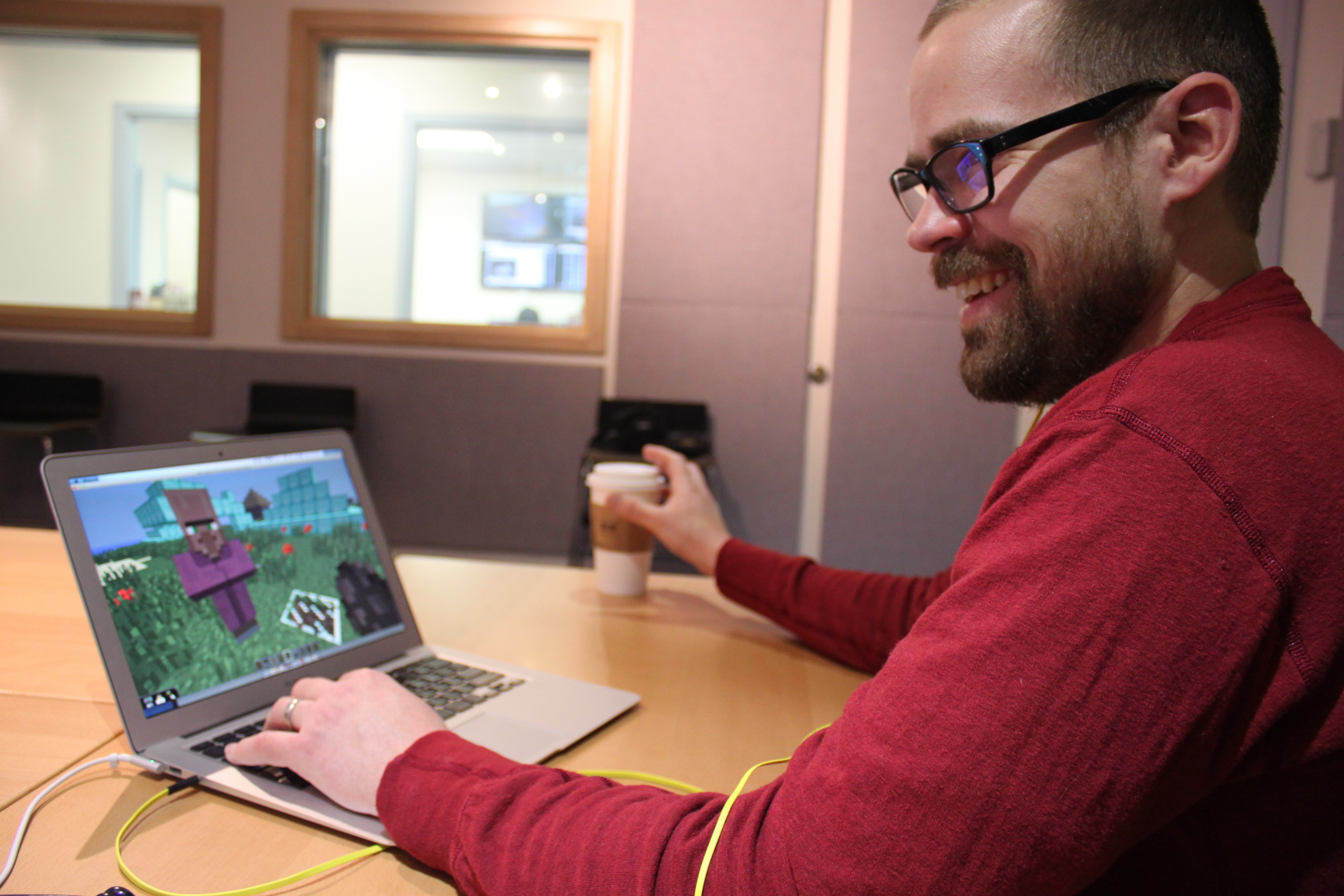 "UAS graduate student Colin Osterhout recreated the area of the ""Monster Lobe"" inside Minecraft. He's also built Juneau and Douglas in the virtual world. (Photo by Lisa Phu/KTOO)"