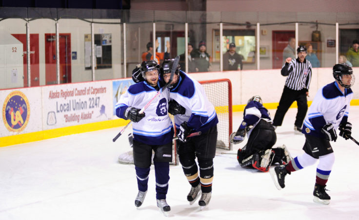 Joe Bankowski (left) celebrate's his goal with Alaska Airlines teammate Matt DuBois.