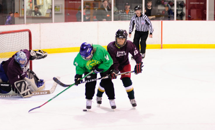 Treadwell's Nandi Than keeps Janice McLean as the puck makes its way toward goalie Jodie Pessalano.
