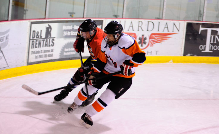 Kensington's Mike Bovitz catches Island Pub's Kellen Kraft ultimately stripping Kraft of the puck.