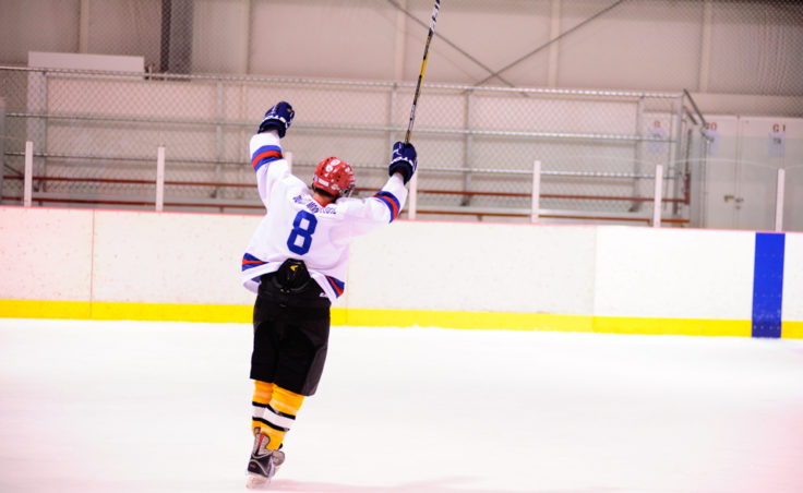 A-Bombs' Arnold Liebelt celebrates a goal by teammate Greg Germain, who broke a 3-3 versus Dupont in the waning seconds of the 40+ Tier title game.