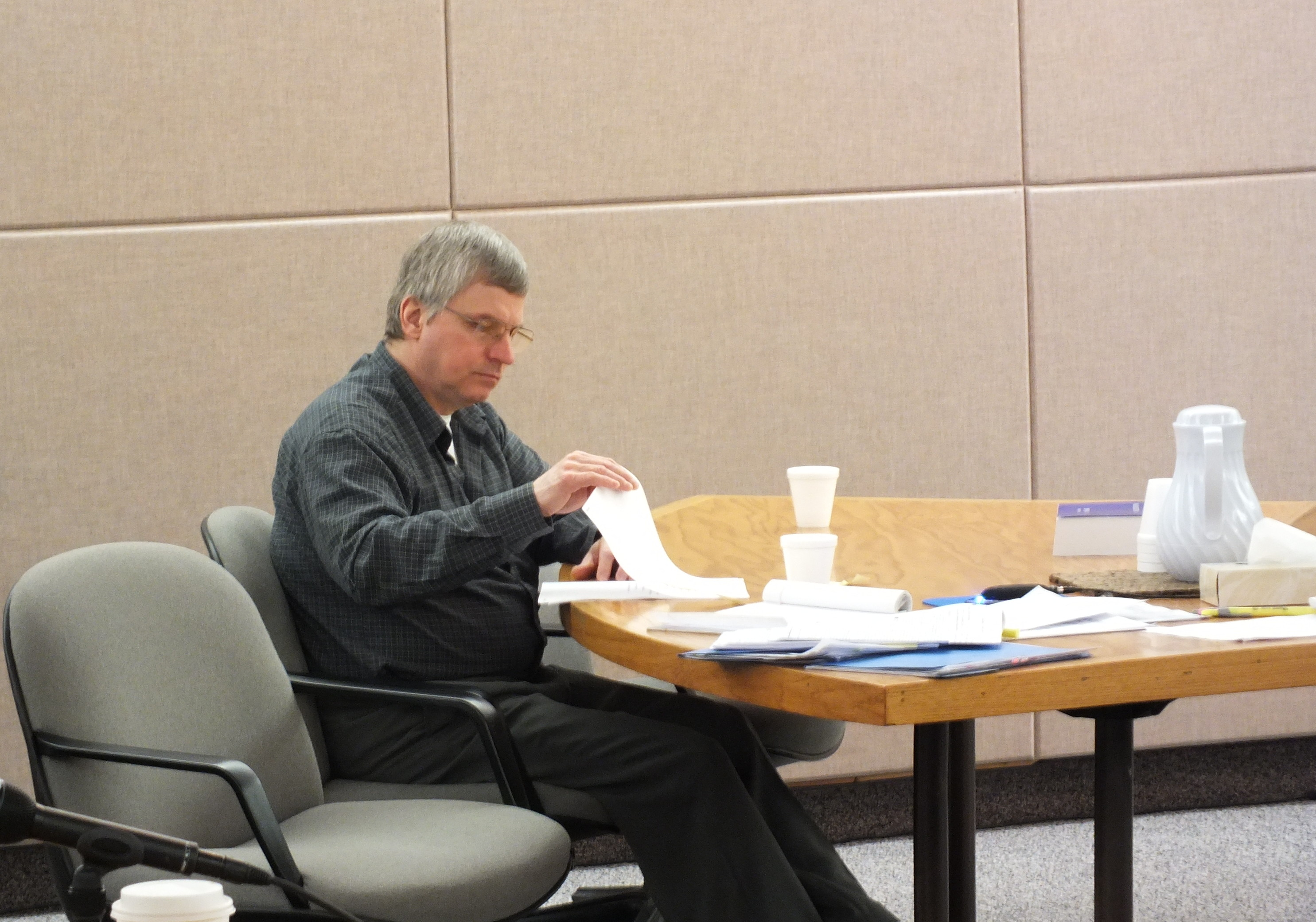 Defendant Robert Kowalski reviews some documents during his trial on Tuesday. (Photo by Matt Miller/KTOO)