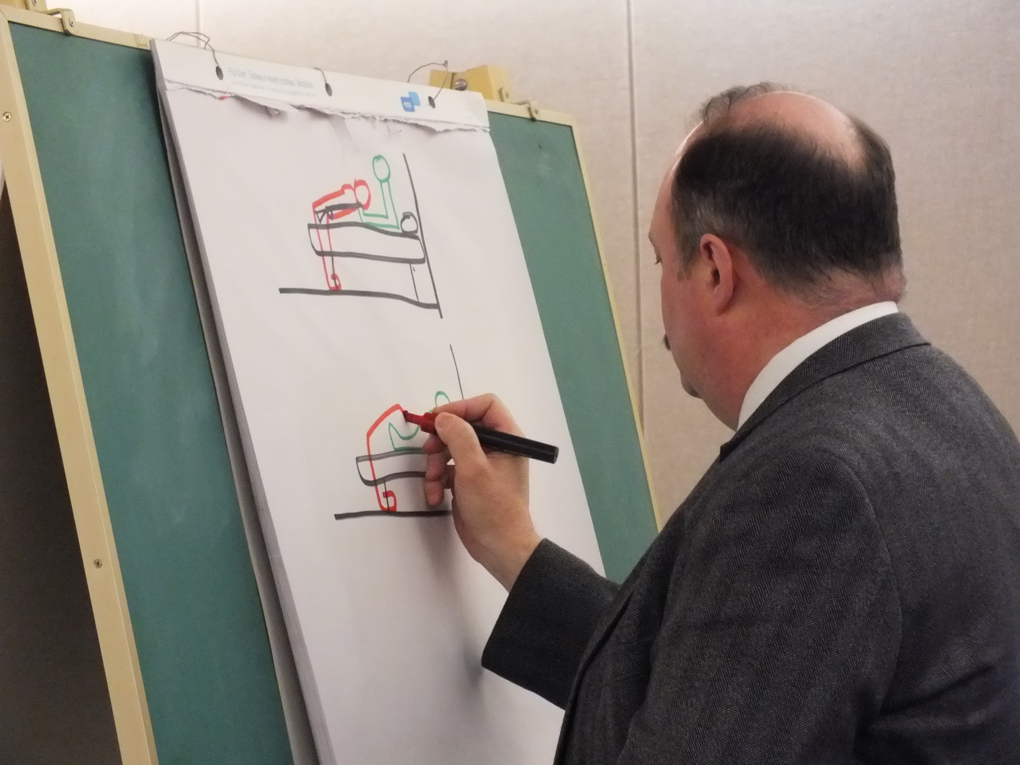 Investigator Randel McPherron quickly sketches out an exhibit to be used for cross examination of a defense witness. (Photo by Matt Miller/KTOO)
