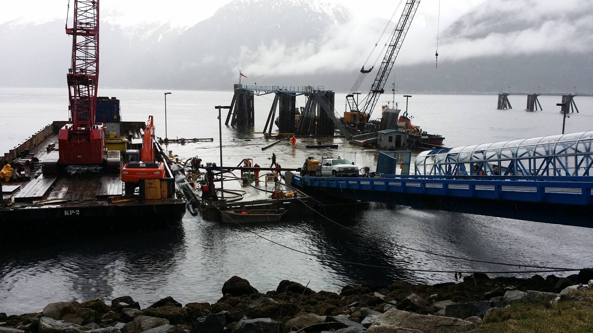 Western Marine Construction began working early Tuesday to refloat the dock. (Photo courtesy Jeremy Stephens, Alaska DOT&PF)