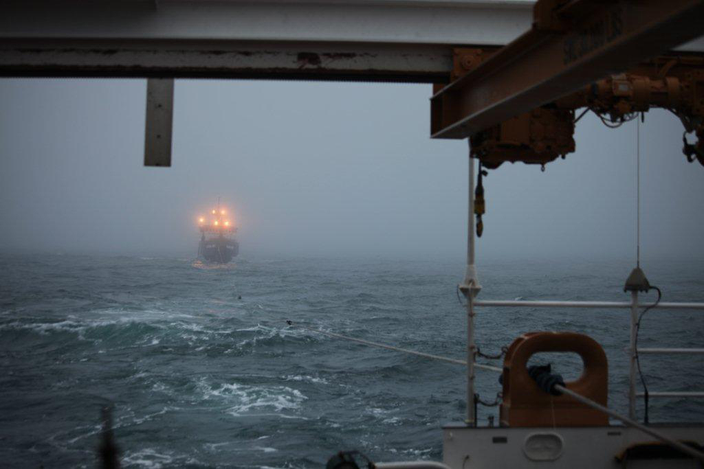 The Coast Guard Cutter Waesche tows the fishing vessel Alaska Mist through the Bering Sea near Amak Island, Alaska, Nov. 13, 2013. Joint effort between the crew of the Coast Guard Cutter Waesche, a Coast Guard Air Station Kodiak MH-60 Jayhawk helicopter crew, the 207-foot tug Resolve Pioneer and the fishing vessel Pavlof resulted in the successful tow of the Alaska Mist and safe disembarkation of the crew to Dutch Harbor. (U.S. Coast Guard photo by Coast Guard Cutter Waesche)