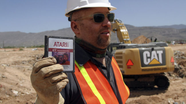 Film director Zak Penn shows a cartridge of the Atari game E.T. The Extra-Terrestrial, which was released in 1982. Millions of copies of the game are rumored to be in a New Mexico landfill. Juan Carlos Llorca/AP