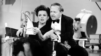 Judy Garland and Mickey Rooney put their heads together over a TV script for their first onstage reunion in 18 years in this 1963 photo. AP