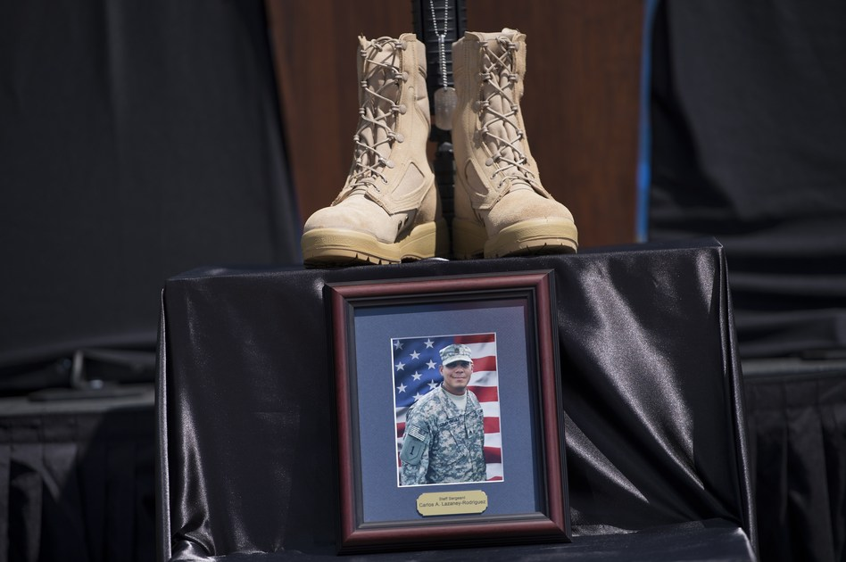 A memorial for Staff Sgt. Carlos Lazaney Rodriguez is seen before a service at Fort Hood on Wednesday. Brendan Smialowski /AFP/Getty Images