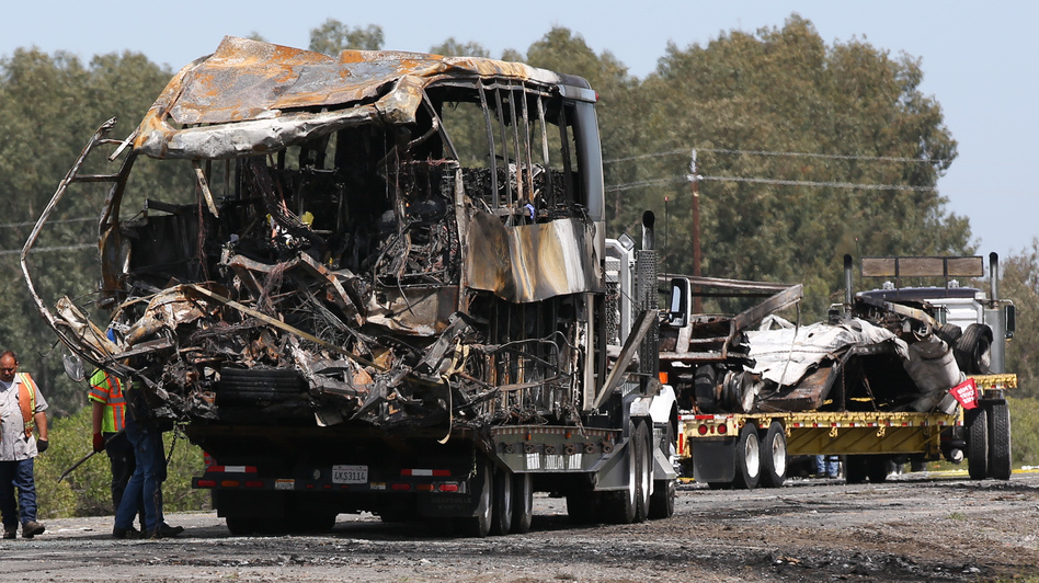 The remains of a FedEx truck (right) and a bus involved in a crash Thursday are taken from the scene of the accident in Orland, Calif., by flatbed trucks on Friday. The students had been on their way to visit Humboldt State University in Northern California. Elijah Nouvelage /Getty Images
