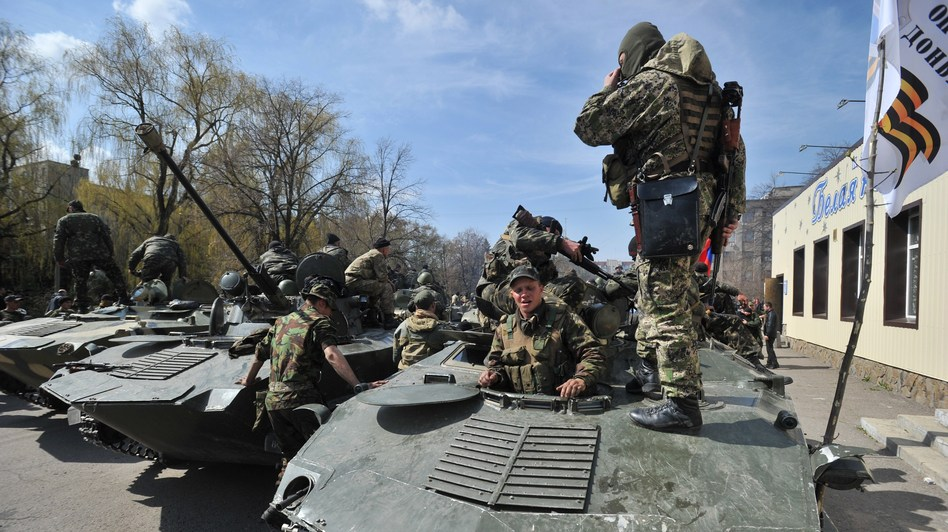 Armed men wearing military fatigues gathered on armored personnel carriers Wednesday in the eastern Ukrainian city of Slovyansk, where they and other pro-Russia gunmen took control of some key locations. Genya Savilov /AFP/Getty Images