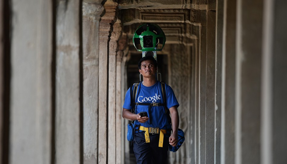 "A Cambodian technician carries a backpack-mounted ""Trekker"" device housing 15 cameras as he demonstrates the technique used to digitally map the Angkor complex in Cambodia. Christophe Archambault/AFP/Getty Images"