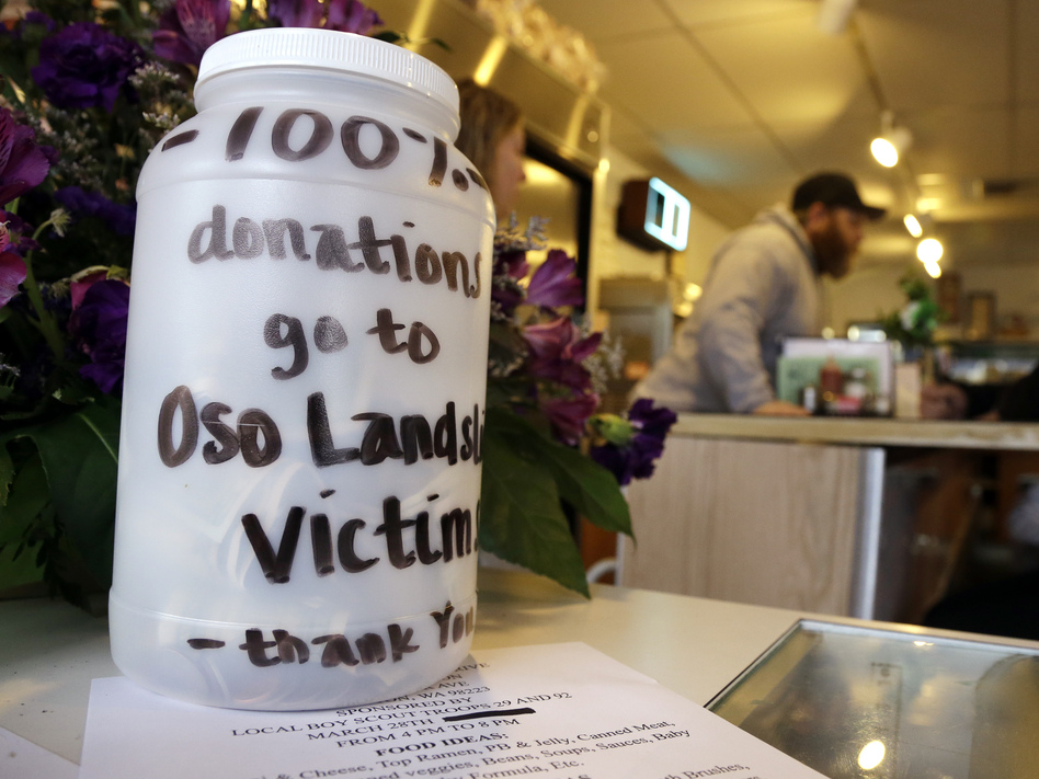 In Arlington, Wash., neighbors and businesses are raising money for the families of those affected by the mudslide in Oso, a part of that city. Elaine Thompson/AP