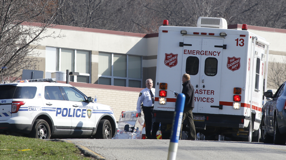 Emergency responders gather in the parking lot on the campus of Franklin Regional High School in Murraysville, Pa., on Wednesday after an attack there left at least 20 people, nearly all of them students, injured. Most suffered stab wounds or lacerations. Keith Srakocic/AP